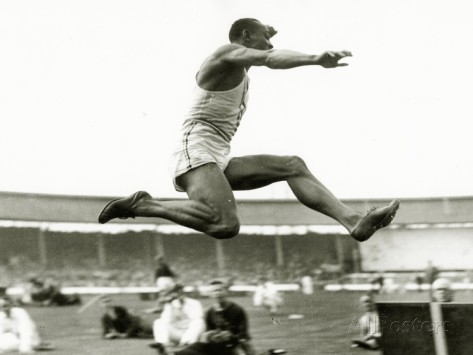 jesse-owens-in-action-at-the-long-jump-during-the-berlin-olympics-1936
